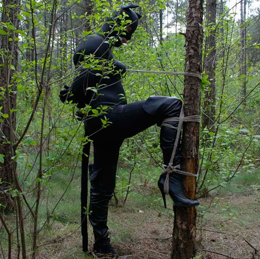 extreme outdoor bondage in the forest with Mistress Dewi